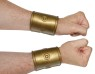Roman Wrist Band - Flexible gold-colored plastic cuffs with elastic for a comfortable adjustable fit. Sold by the pair.