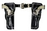 Decorated leather holsters with belt. Includes two die-cast repeater cap pistols.