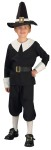 Pilgrim Boy Child Costume - Black cotton shirt with white lapels and white folded sleeve cuffs. Black cotton pants with elastic at the knee. Black belt with gold clasp and black cotton hat with white strip and gold square accent.
