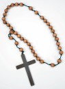 Monk Cross With Wooden Beads - Plastic monks cross with stylistic wooden beads attached.