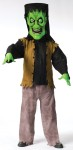 Bobble Head Monster Adult Costume - Pullover top with attached vest, pants, and bobble eyes in a lightweight head with comfortable interior elastic head support. For child size see style FW130092.