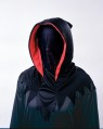 Hooded mask that when worn allows the wearers face to not be seen, but the wearer can see out.